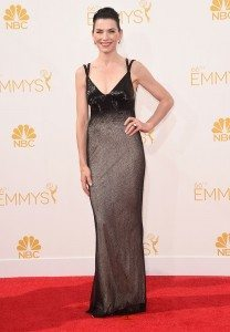 Julianna Marguiles wore a low cut dress in black and silver.